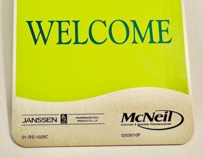 Janssen Door Knob Sign McNeil New WELCOME Side Closeup